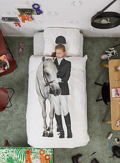 """Snurk collection from Amsterdam at Simons Maison. When you are a horse lover, you love them with all your heart. Long afternoons spent at the stables and posters covering your walls... You read and talk about horses, maybe even had one yourself! But we bet wild horses couldn't tear you away from your bed now. Yeeha! The set includes: Twin: 1 duvet cover 66"""" x 90"""", 1 pillow sham 20"""" x 26"""" *Home decor shown is for illustrative purposes only."""