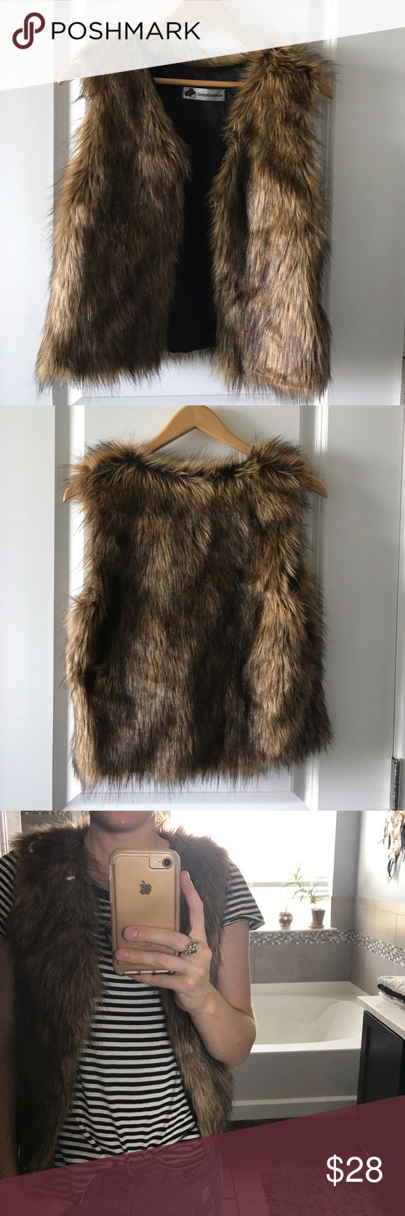Faux fur vest Faux fur vest in brown and black. 19 1/2 inch in length. Great layering piece for fall and winter! 20% poly, 80 acryl. No size listed but best for xs and small IMO. I'm usually a small. Jackets & Coats Vests