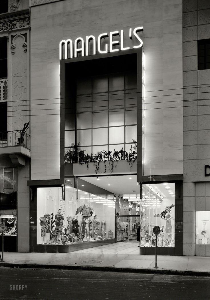 "Shorpy Historical Photo Archive :: Foot Traffic: 1942January 21, 1942. ""Mangel's, 130 E. Flagler Street, Miami, Florida. Exterior, night. Ross-Frankel Inc., client; Morris Lapidus, architect."" Note the ghost pedestrians. Large-format acetate negative by Gottscho-Schleisner."