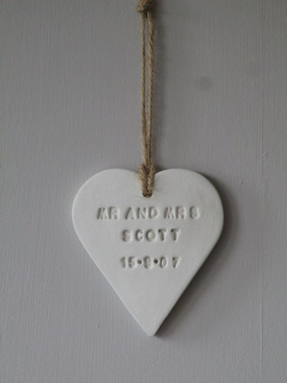 Hanging Clay Mr and Mrs Heart, personalised with the surname and wedding date.  The heart is made from white air drying clay and measures
