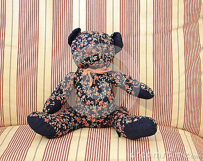 A teddy-bear on a sofa