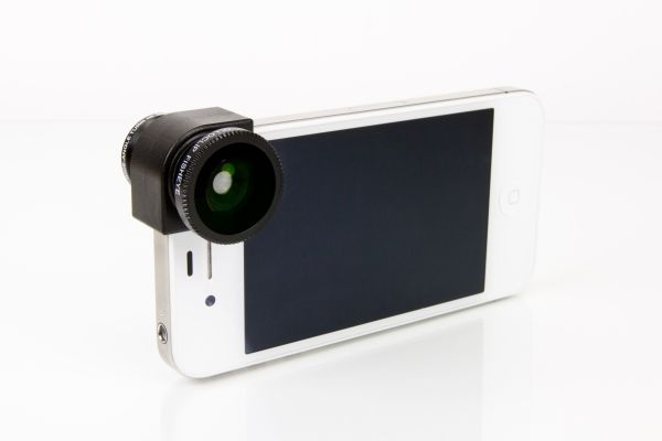 The Olloclip 3-in-1 iPhone Lens - A three-in-one lens system that fits over the corner of your iPhone for easy access. ($70.00, http://photojojo.com/store)