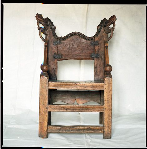Gålås Chair with carved animal heads. The backrest is 13th century from Gålås, Ringsaker, C26500, Fotoportalen UNIMUS. Front and sides are thought to be from a restoration in 1712 but in keeping with the original look while the back is original. The back side has animal and plant ornament.