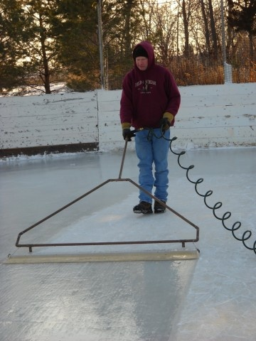 """Grooming the rink with his homemade """"Zamboni"""""""