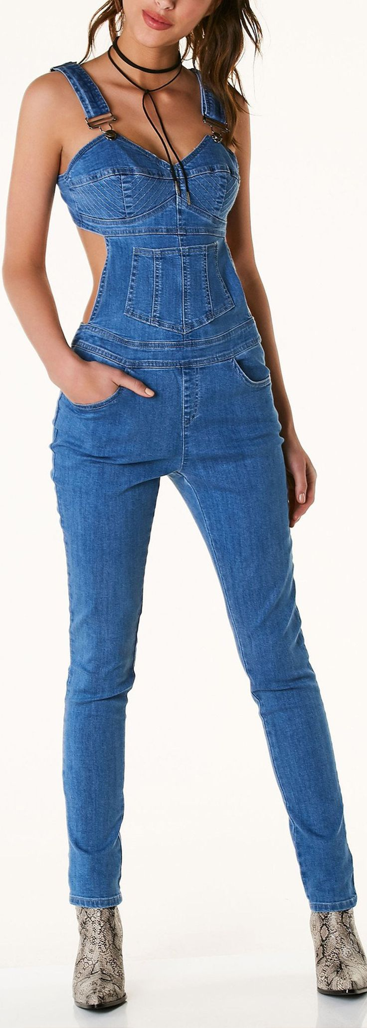 Slim fit denim overalls with V-neckline and adjustable shoulder straps. Five pockets with bustier style design in front and cut out in back. Zippers for closure and silver hardware detailing. - Cotton