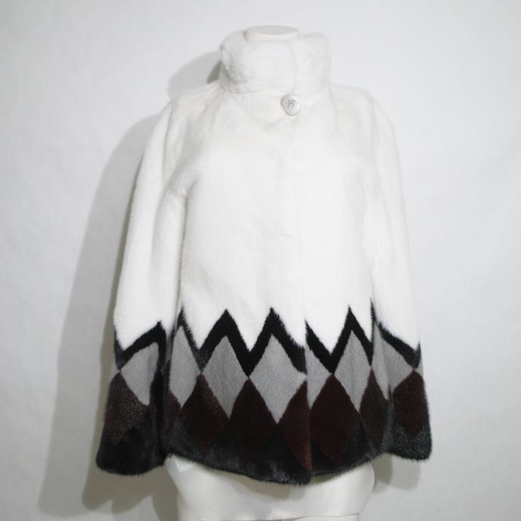 Geometrical shapes define this fashionable white, grey and black mink fur jacket.