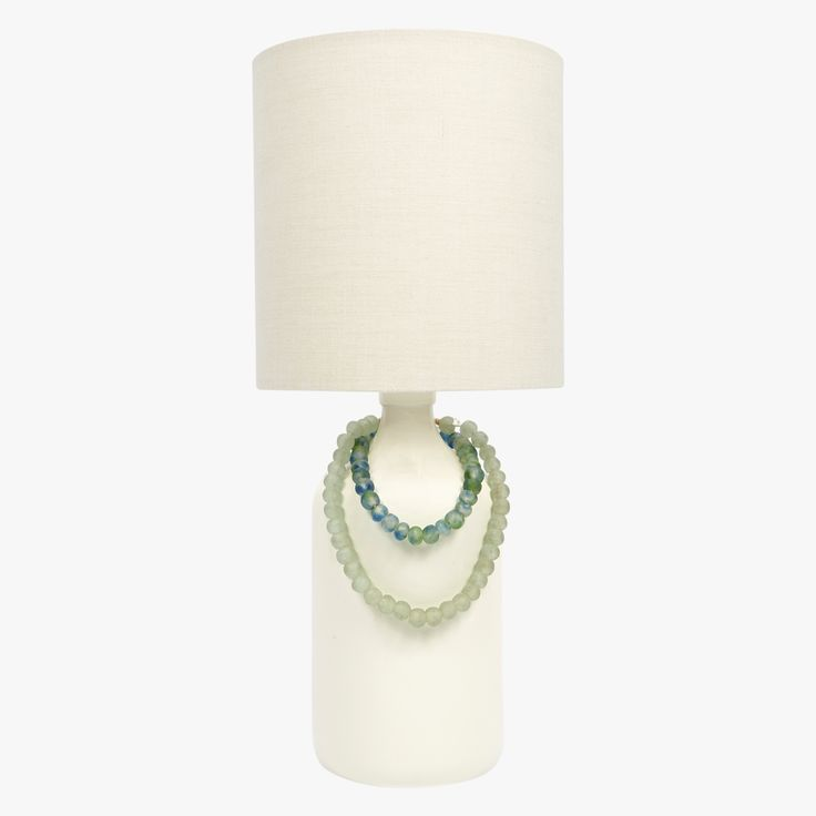 Our Seaglass Bead Eggshell Ceramic Lamp is a versatile, neutral table lamp perfect for any decor. This chic glazed ceramic lamp is a designer favorite.