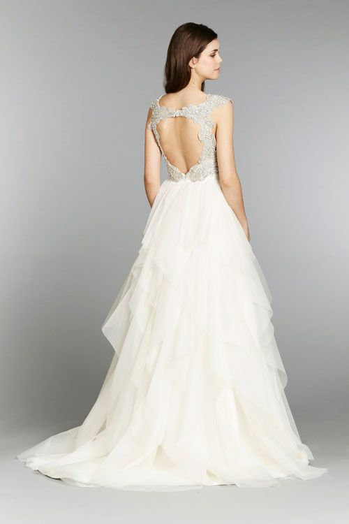 Brand new never worn Ivory English Net A·line natural waist bridal gown with draped sweetheart bodice, tiered flounce skirt, crystal straps, keyhole back, and chapel train. Altered on top but never sh