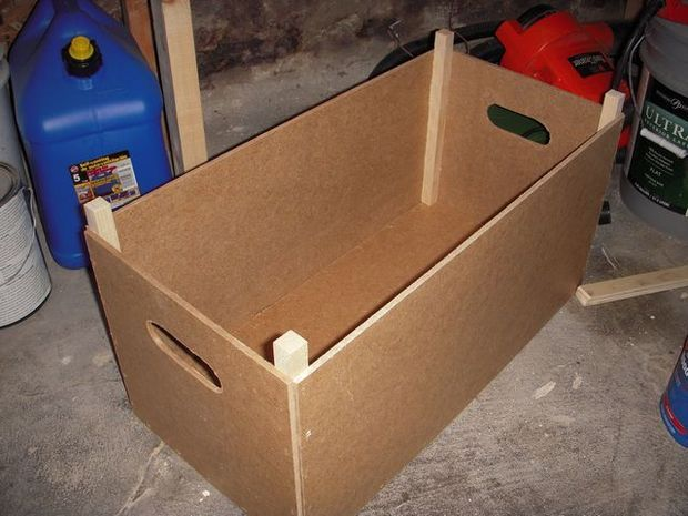 Stackable wooden box.  This would make a great base to put a litter box in!  Put a divider in the midle, and a shelf on top, so things can be stored in one side and keep food bowls on top.  Then put in a climbing post and nesting areas for the cat on top of it all.