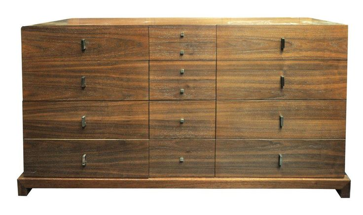 This vintage Mid-Century Modern dresser holds the key to all your storage needs! It features twelve deep drawers with original hardware. The walnut piece will add warmth to any bedroom or dining space if you choose to designate it as a credenza!