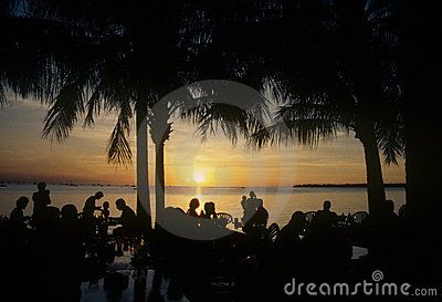 Stock Photo: People enjoying food and drinks at sunset, Darwin Harbour, Australia.
