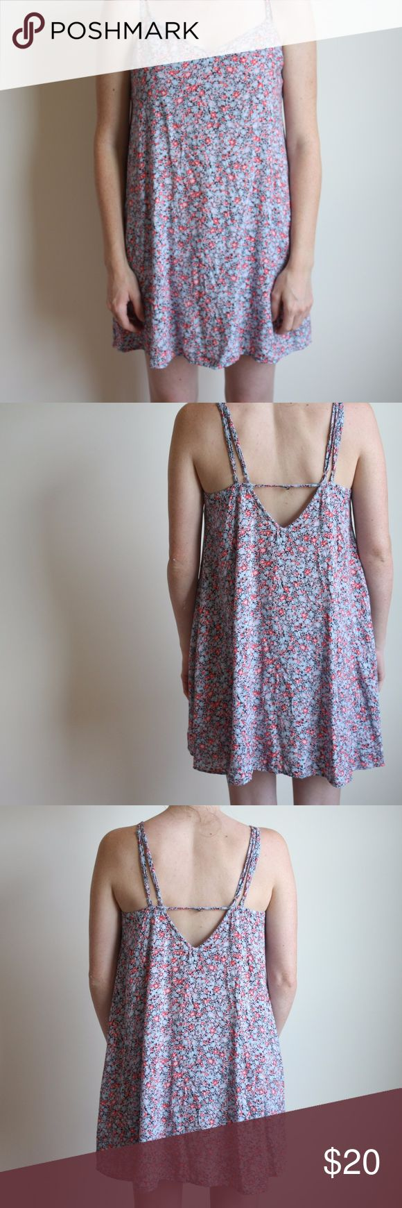 🌸24 HR FINAL CLEARANCE🌸 Floral Swing Dress Gently used. No signs of wear. This swing dress is sooo dreamy and flirty. Small wildflowers printed on the fabric make it so adorable! One small button in the back to gather the straps to ensure it wont slip off your shoulder! So breezy and lightweight. Super soft.  -Size Small but can fit a medium American Eagle Outfitters Dresses Mini