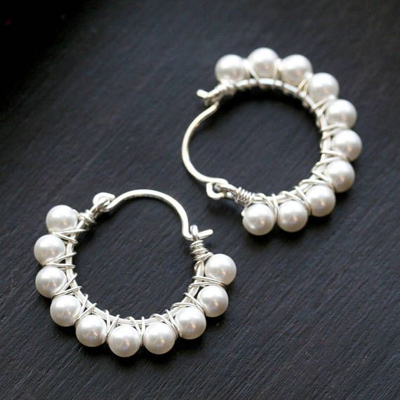 Shimmery, white Swarovski crystal pearls adorn these sterling silver horseshoe shaped hoop earrings. Each 4mm pearl is wrapped with sterling silver wire onto hand shaped sterling silver hoop forms. Ear wires are made from 20 gauge sterling silver wire. These dainty and petite