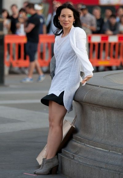 "Lucy Liu in Trafalgar Square, London, filming the 2nd-season opener of ""Elementary."""