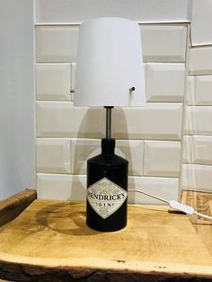 Homemade lamp made from a Hendricks gin bottle. Height with shade: 42cm Width with shade: 15.5cm The lamp comes fully fitted with a lampshade, although this can be replaced later if wanted. The lamp fits an E14 bulb. Lots of designs available so keep watching if the first one doesnt