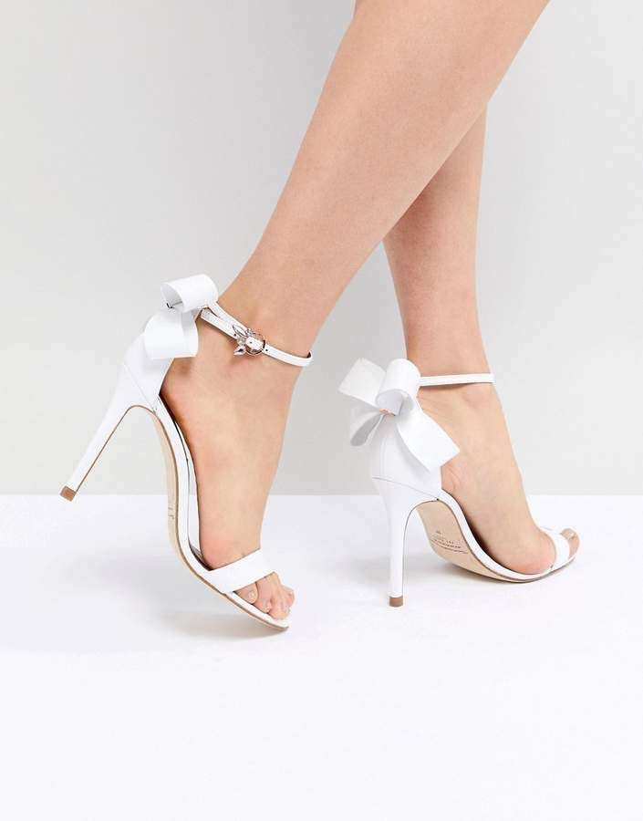 df3bdbcbc Ted Baker Sandas Bow Detail White Leather Sandal. The details on these heels  are so great. Super cute. #heels #bows #affiliate. Find this Pin and ...