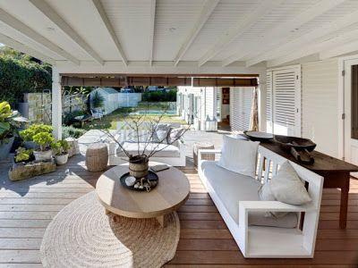 White weatherboard cottage—a beautiful place to read, rain or shine.