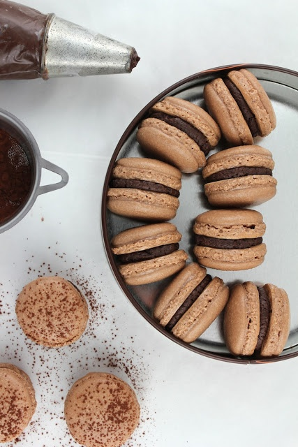 Chocolate Gingerbread Macarons - I was talking with a friend of mine, and she was saying how hard it is to make Macarons. Of course, I took that as a challenge, so pinning recipes now....