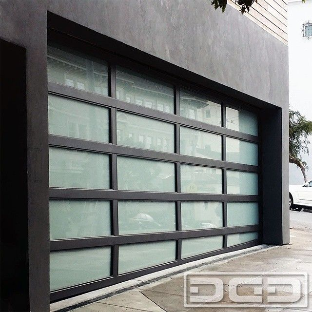Metal Glass Garage Doors With Sloping Bottom Section Custom Made For A San Francisco Ca Modern Hom Contemporary Garage Doors Garage Door Types Roller Doors