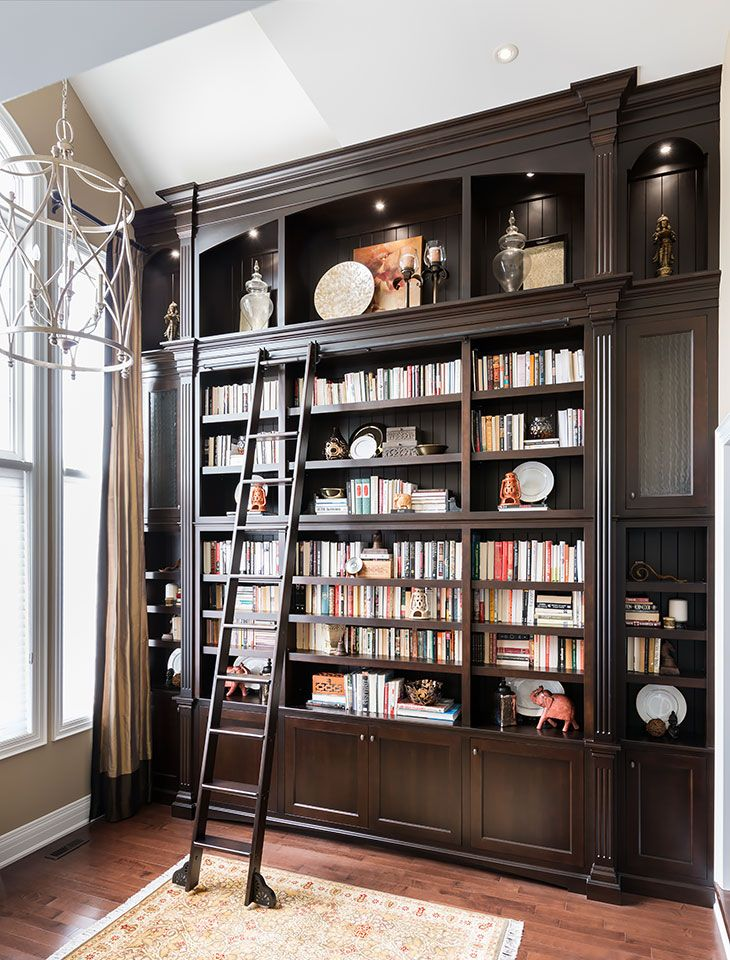 Dark wood bookcase with ladder on rail |  Jane Lockhart Interior Design