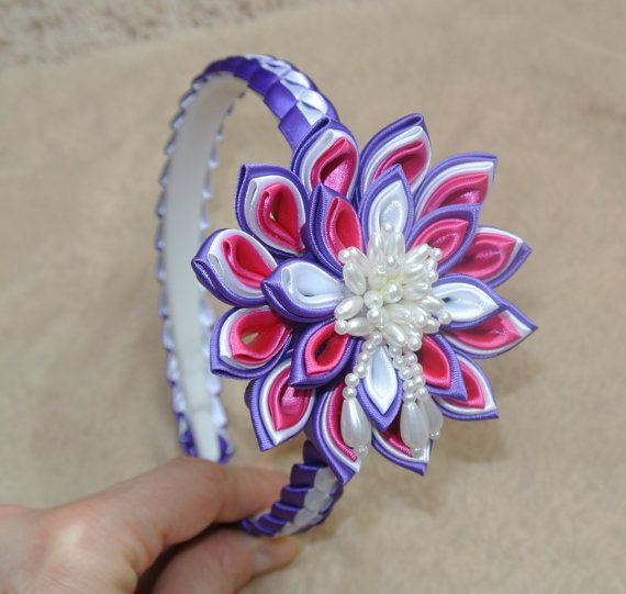 This lovely headband made in the technique of Kanzashi from satin ribbon. Plastic headband braided with satin ribbon. The diameter of the flower