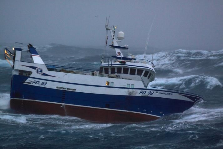 A Newfoundland Crab boat, owned by Ross Petten from Port de Grave, navigates some choppy water ...