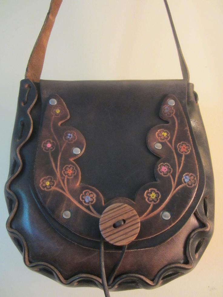 Vintage 1960s Hand Tooled Leather Saddle Bag - Boho Shoulder Bag - Flower Design - Wood Button - Flower Child Bag. $38.00, via Etsy.