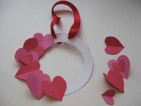 Kids Valentine Day Crafts | begin gluing on your hearts onto the Valentine wreath.