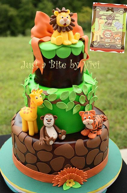Jungle animal themed baby shower cake (lion, giraffe, monkey, tiger) - this might be out of the realm of reality, but it's pretty awesome :)