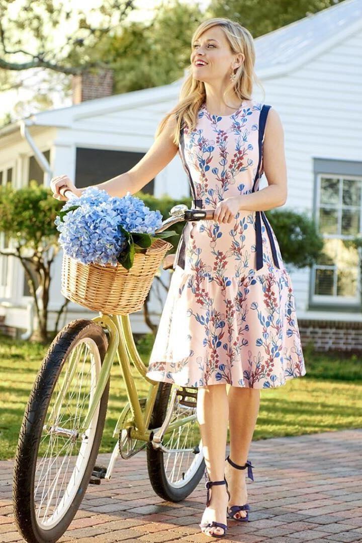 Reese Witherspoon wearing Alexandre Birman Clarita Heels and Draper James Dunaway Vines Bow Dress