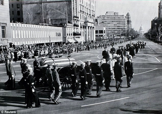 11/24/63: JFK's casket is carried on a military caisson to the Capitol to lie in state in the Rotunda.