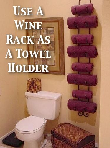 This one speaks for itself. A wall mounted wine rack seems to hold rolled towels like a champ. This is a good solution for a small bathroom.