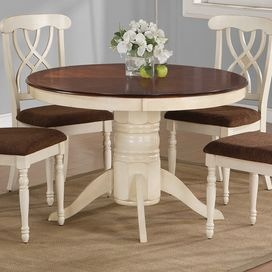 """Pedestal dining table in buttermilk with a dark cherry-finished surface.    Product: Dining tableConstruction Material: WoodColor: Buttermilk and dark cherryFeatures:  Cottage styleWill enhance any setting Note: Chairs not includedDimensions: 30"""" H x 48"""" Diameter"""