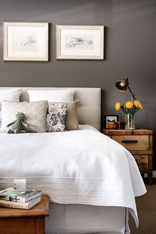 Love the darker gray walls with soft gray & white bedding. Beautiful wood accents. too.