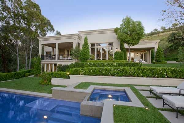 Lady Gaga rents this Bel Air mansion  while in California. This 6,143 square-foot Beverly Hills mansion with a huge pool and jacuzzi tub costs her $25,000 a month. Lady Gaga's California Mansion features marble and expensive woods. The double height entry has marble flooring and curvy staircase.