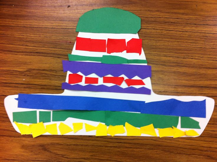We made sombreros for Cinco de Mayo using paper scraps and dot markers. Then we attached them to a sentence strip to wear throughout the da...