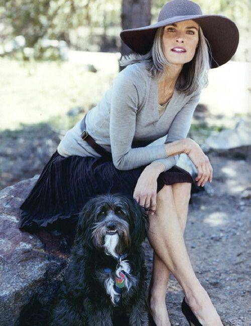 A sunhat is always right Roxanne Gould, Portuguese water dog, grey hair older women