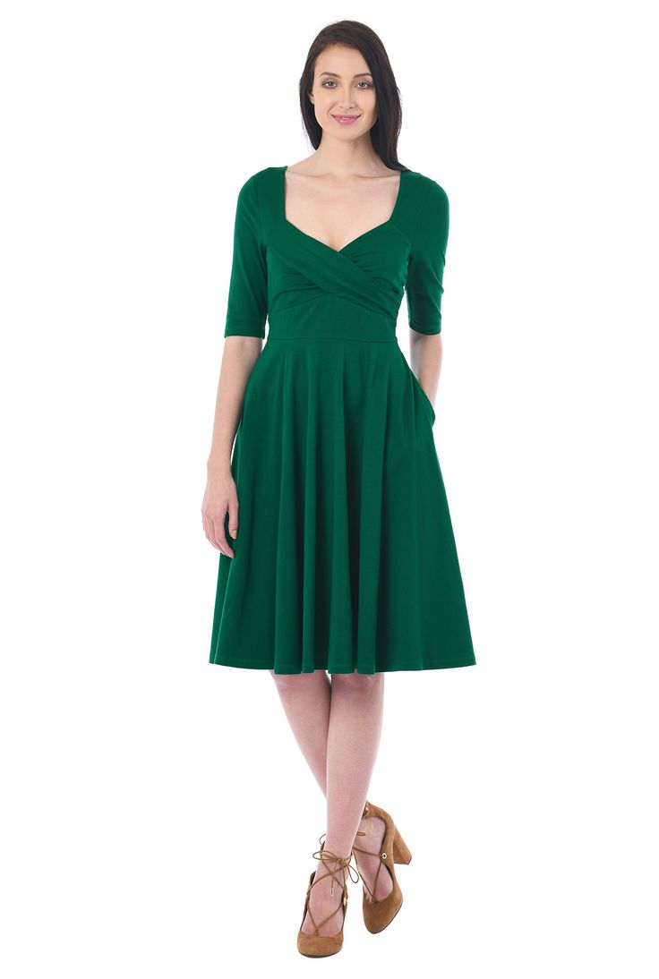 Our cotton jersey knit dress is styled with a sweetheart neckline, pleated surplice bodice and full flare skirt for classic flattery.