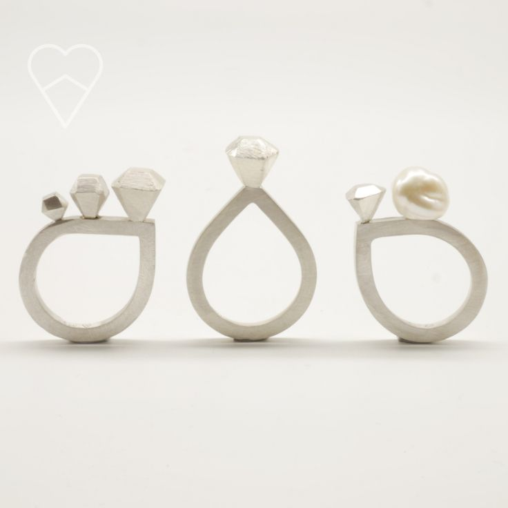 Three diamond rings. Cast and hand filed silver rough cut diamonds, and a baroque pearl.