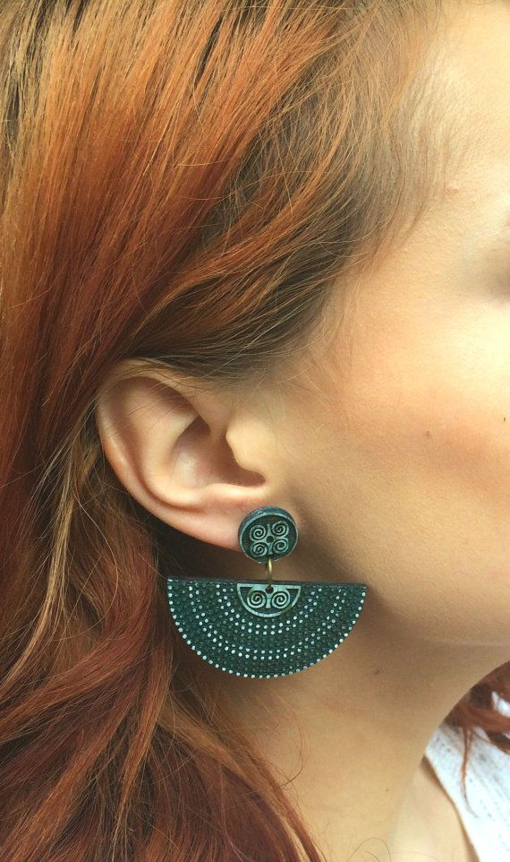 Check out this item in my Etsy shop https://www.etsy.com/listing/269983542/earthy-tribal-earrings-laser-cut