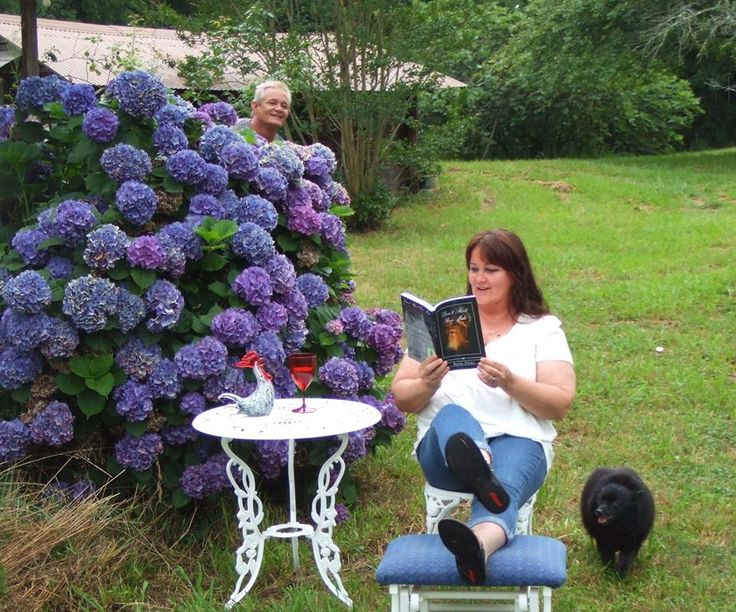 Love this classic Alabama pic of my gorgeous friend Deb Tucker with Don't Shoot Your Mule. Hydrangeas, a beautiful wine glass, a rooster and a brotherly photobomb...it doesn't get better than this!