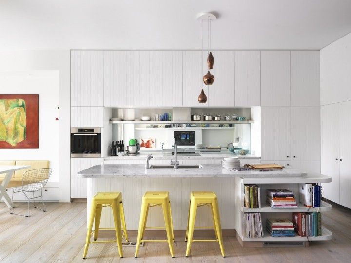 Our kitchen even with curved island bench; white timber tongue and groove kitchen; honed Carrera marble top, stainless steel shelf and mirror splashblack; floorboards are Porters wide board limed American Oak