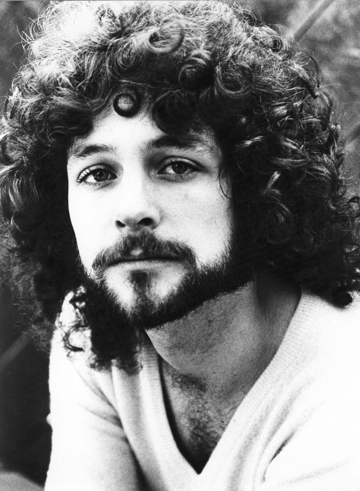 Lindsey Buckingham...hotness if ya can just look past the 70s fro   - look past it? Its glorious