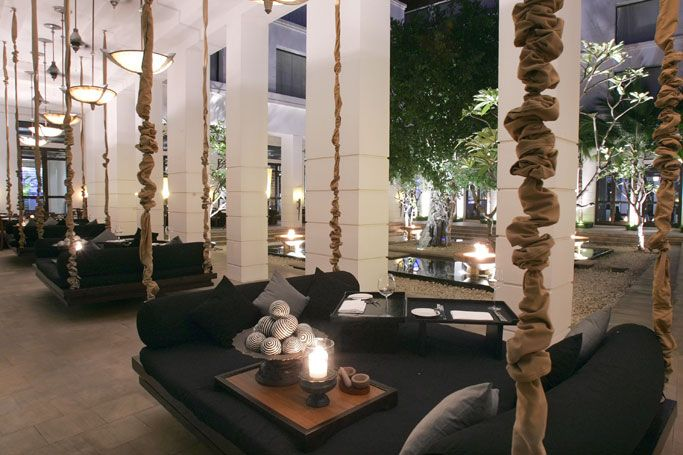 Swing dining in the Fire Garden Courtyard adjacent to Meric restaurant at Hotel de la Paix in Siem Reap, Cambodia by Bill Bensley