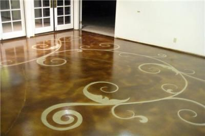 Very cool concrete floor by Nevada's Floor Seasons. Design created by using PVC pipe and pieces of metal cut into swirl and leaf shapes.