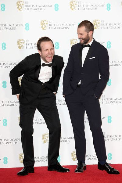 Jamie Dornan Photos Photos - Presenters Rafe Spall and Jamie Dornan pose in the winners room during the 70th EE British Academy Film Awards (BAFTA) at Royal Albert Hall on February 12, 2017 in London, England. - EE British Academy Film Awards - Winners Room