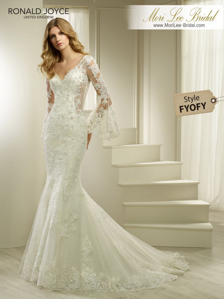 Style FYOFY HUDSON A SATIN AND ORGANZA FISHTAIL DRESS WITH LACE APPLIQUES, UNIQUE ILLUSION PANELS AND BELL SLEEVES. DRESS COMES WITH A REMOVABLE BODICE LINING – NOT PHOTOGRAPHED. PICTURED IN IVORY.AVAILABLE IN 3 LENGTHS: 55', 58' AND 61' COLOURSWHITE, IVORY