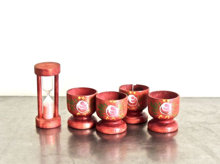 Midcentury carved/painted wood egg cups set with wall-mount stand. #eggcups #midcenturykitchen https://www.etsy.com/listing/521070437/vintage-egg-cups-timer-set-1960s-mid