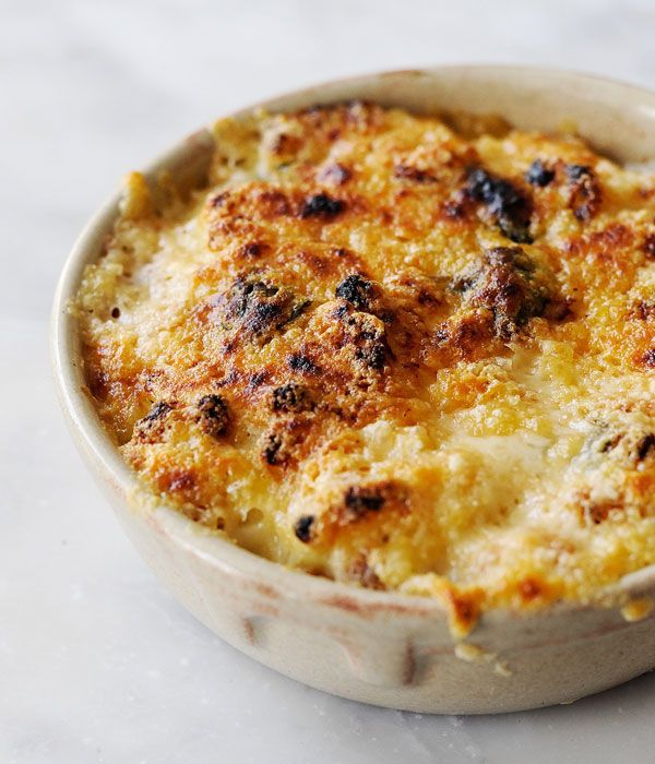 Tom Aikens demonstrates how to make the perfect macaroni cheese, using milk infused with bay and thyme, fresh basil and Dijon mustard. Tom uses both Gruyère and Parmesan for the cheese in this macaroni cheese recipe, which gives this common dish a satisfyingly rich flavour, but if you are looking to make this recipe for vegetarians, select cheeses made with vegetarian rennet.