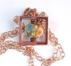 Copper frame lampwork bead necklace